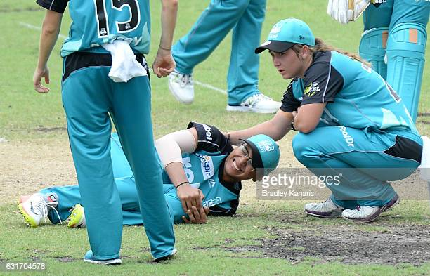 Smriti Mandhana of the Heat is injured during the Women's Big Bash League match between the Melbourne Renegades and the Brisbane Heat at Allan Border...