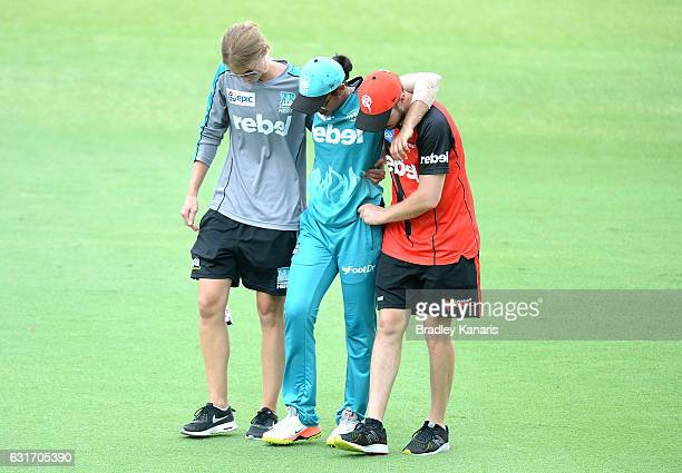 Smriti Mandhana of the Heat is taken from the field injured during the Women's Big Bash League match between the Melbourne Renegades and the Brisbane...