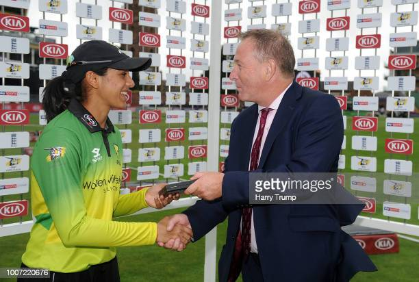Smriti Mandhana of Western Storm is presented with the player of the match by Andrew Cornish CEO of Somerset during the Kia Super League match...