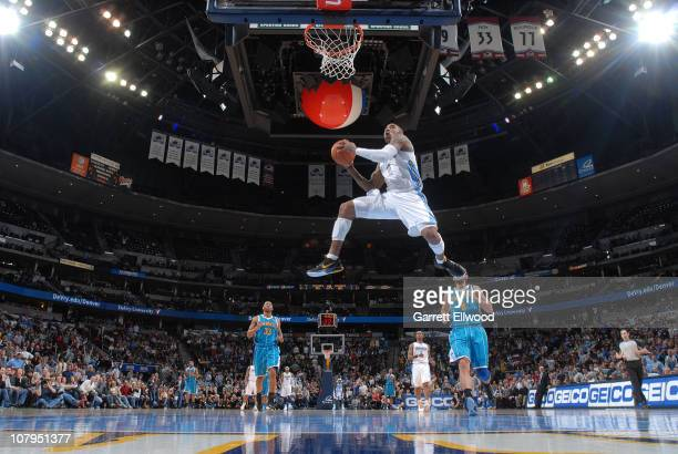 R Smtih of the Denver Nuggets goes to the basket against the New Orleans Hornets on January 9 2011 at the Pepsi Center in Denver Colorado NOTE TO...