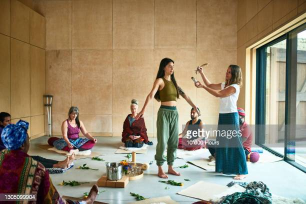 smudging ceremony in yoga class - limb body part stock pictures, royalty-free photos & images