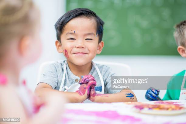 smug boy - craft stock pictures, royalty-free photos & images