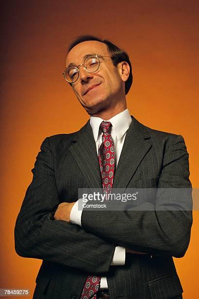 Smug businessman posing with arms folded