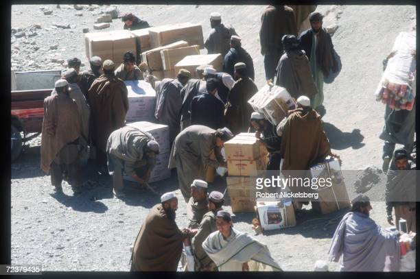 Smugglers arrange contraband March 15 1999 through the Khyber Pass region in Pakistan In order to bypass Islamabad jurisdiction and taxation human...