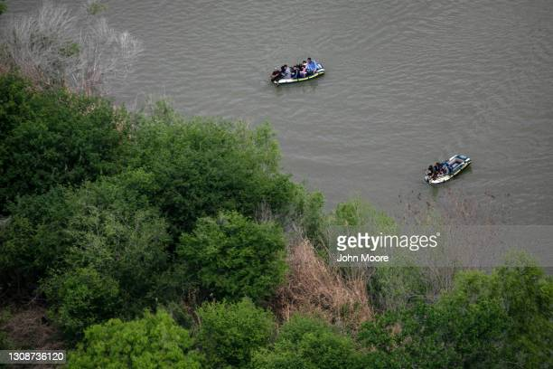 Smugglers ferry asylum seekers across the Rio Grande in dinghies as seen from a Texas Department of Public Safety helicopter near the U.S.-Mexico...