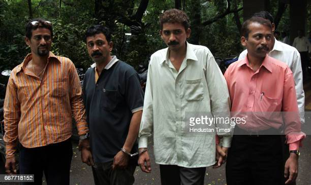 Smuggling Anti Terrorism Squad officers check the sandalwood concealed in white plastic sheets on Thursday Two persons Rajan Malode and Mukesh Patel...