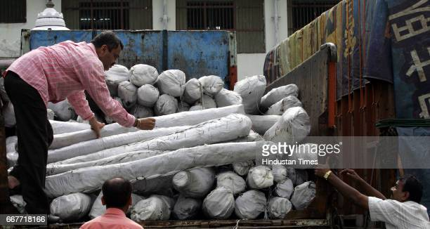 Smuggling Anti Terrorism Squad officers check the sandalwood concealed in white plastic sheets on Thursday Two persons were arrested and sandalwood...