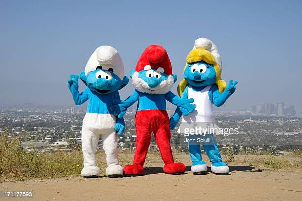 Smurfette Papa Smurf and Clumsy Smurf attend the Global Smurfs Day celebration in Los Angeles on June 22 2013 in Los Angeles California