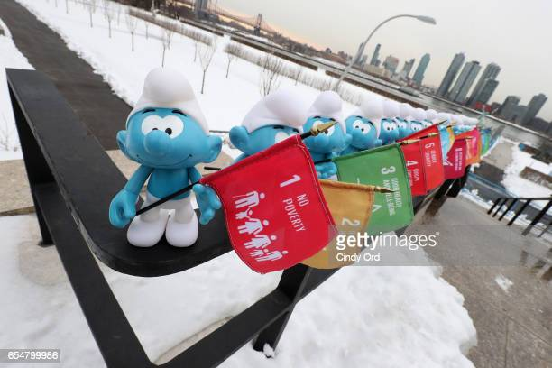 Smurfs hold flags representing the UN's Sustainable Development Goals at the United Nations Headquarters celebrating International Day of Happiness...