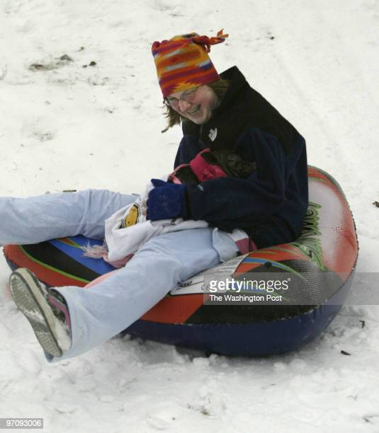 smweather27 012205 Waldorf Md Mark Gail/TWP Westlake high school student Julia Steinsberger and Abagail Jane her potbelly pig enjoy a ride down the...