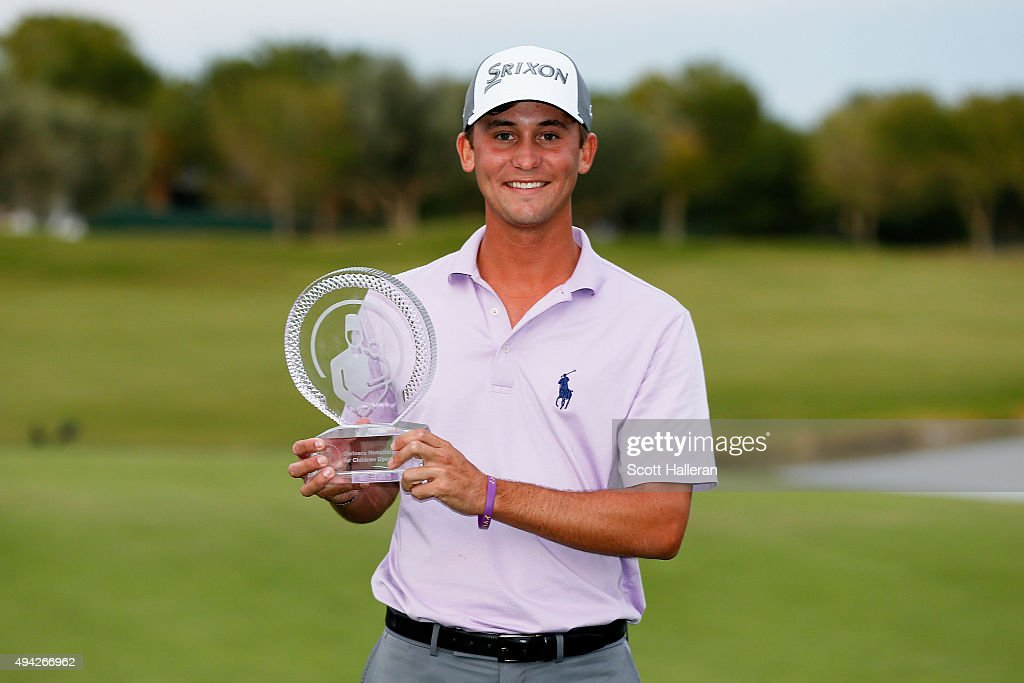 Smylie Kaufman celebrates with the trophy after winning the final round of the Shriners Hospitals For Children Open on October 25, 2015 at TPC Summerlin in Las Vegas, Nevada.