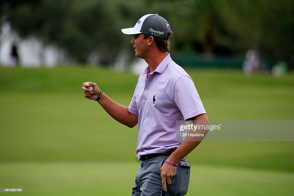 Smylie Kaufman holds up his ball after putting for birdie on the 18th green during the final round of the Shriners Hospitals For Children Open on October 25, 2015 at TPC Summerlin in Las Vegas, Nevada.