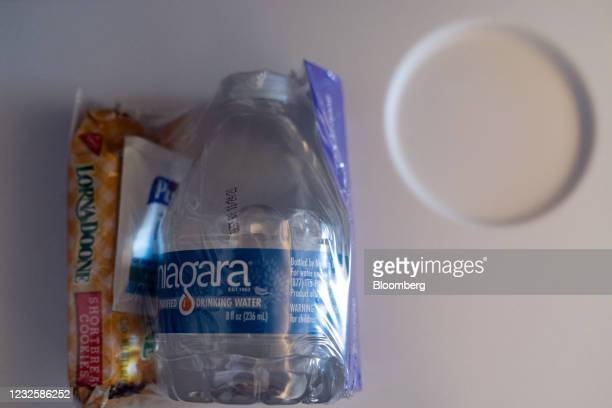 Snack, bottled water, and hand sanitizer sealed in plastic during the Avelo Airlines inaugural flight from Hollywood Burbank Airport in Burbank,...