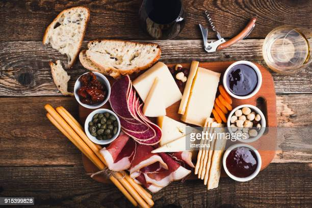 snack finger food on cutting board - italian food stock pictures, royalty-free photos & images