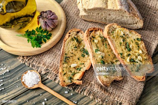 Snack or appetizer of garlic basil and olive oil bruschettas
