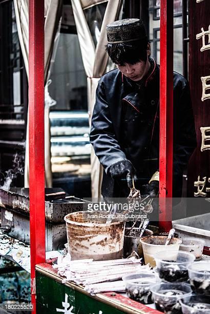 Snack Vendor in Qianmen, comercial district of Beijing, China