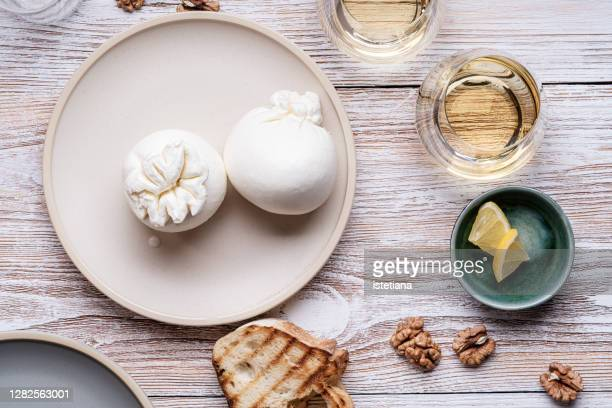 snack with fresh burrata cheese - italian food stock pictures, royalty-free photos & images