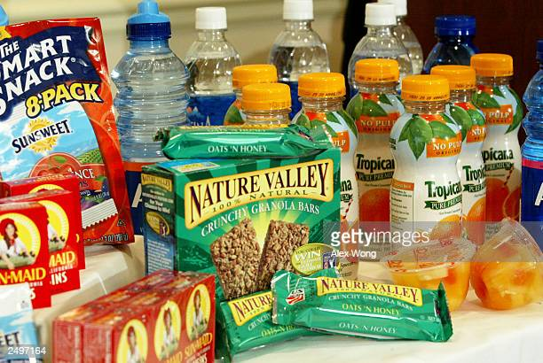 Snacks and drinks with higher nutritional value are displayed during a news conference on school food nutrition September 15 2003 in Washington DC...