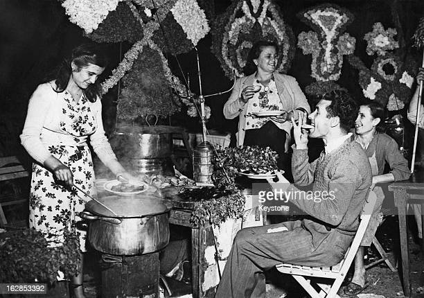 A snail seller at the annual festival of the Madonna of Piedigrotta in Piedigrotta later part of Naples Italy September 1949
