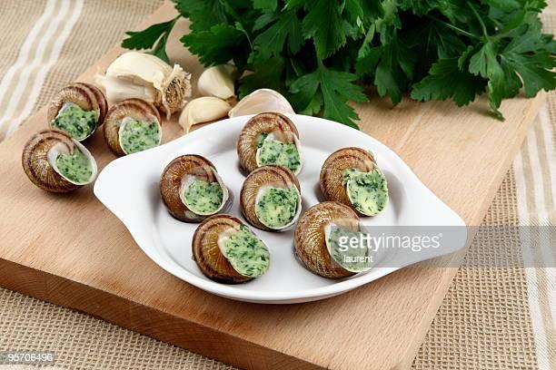 Caracóis com alho e salsa Manteiga