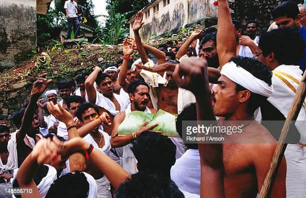 Snake boat crew on temple steps River during Onam festival celebrations.