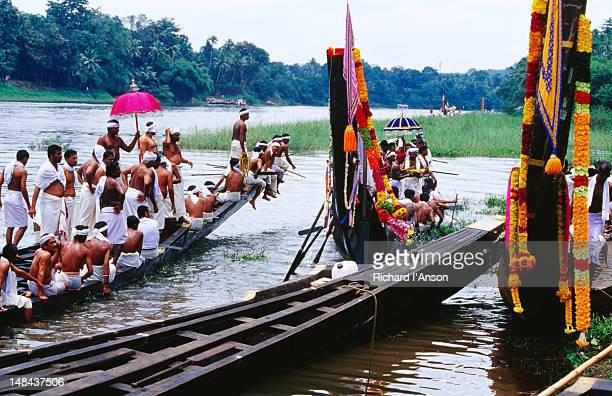 Snake boats at temple ghat (steps) on Pampa River River during Onam festival celebrations.