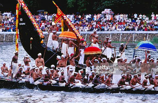 Snake boats in pre-race procession on Pampa River River during Onam festival celebrations.