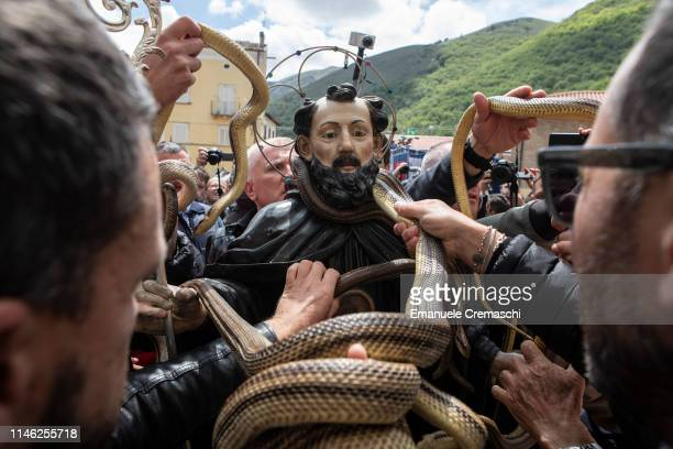 Snake catchers takewild snakesoff a statue of Saint Dominic during a religious procession on May 1 2019 in Cocullo Italy The so called 'Festa dei...