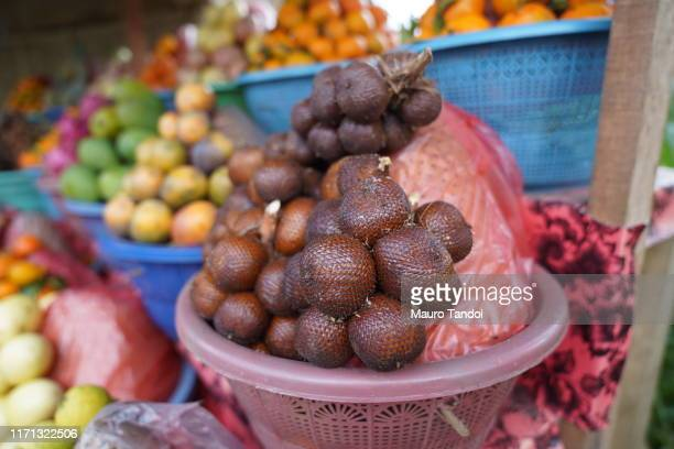 snake fruit, bali, indonesia - mauro tandoi stock photos and pictures