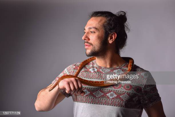 snake pet around my neck - corn snake stock pictures, royalty-free photos & images