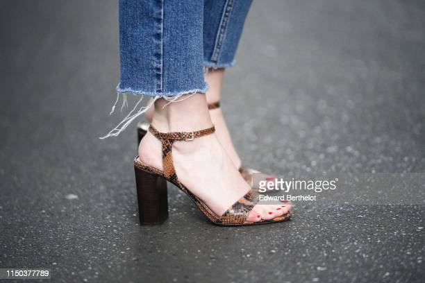Snake print leather heels shoes from Jonak are seen on May 18 2019 in Paris France