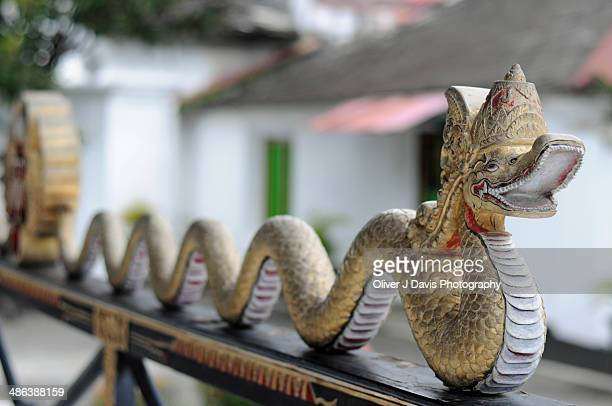 snake sculpture at the sultan's palace (kraton) - yogyakarta stock photos and pictures