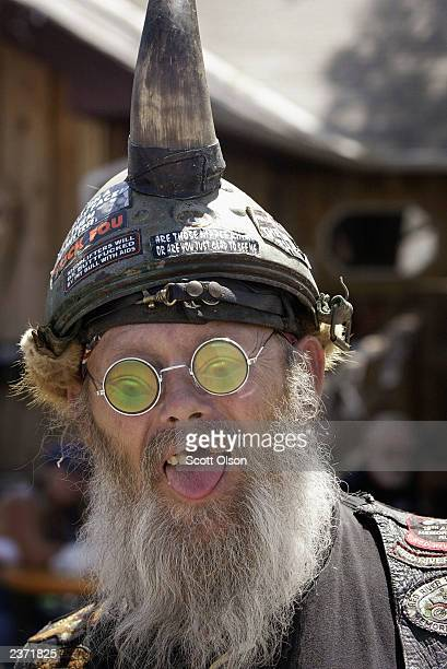 Snake who travelled from Colorado watches as bikes and bikers parade by at the annual Sturgis Motorcycle Rally August 5 2003 in Sturgis South Dakota...