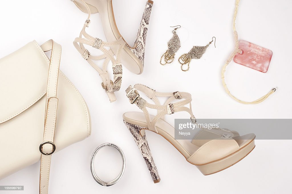 Snakeskin platform heels with earrings bracelet and bag : Stock Photo