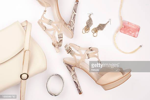 snakeskin platform heels with earrings bracelet and bag - silver shoe stock photos and pictures