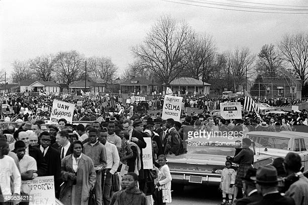 Snaking line of Selma to Montgomery civil rights marchers forming on grounds of the City of St Jude school prior to marching to the state capital...