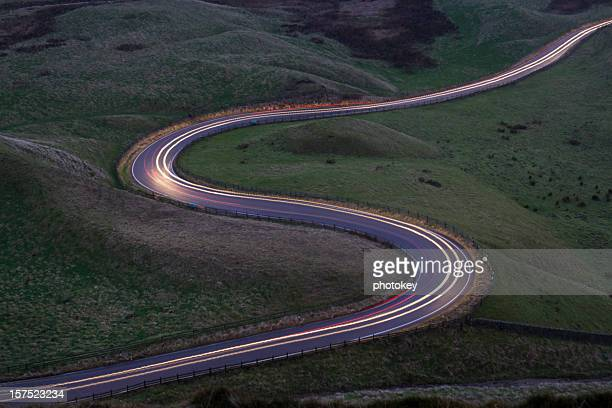 Snaking Road with Car Lights
