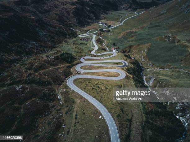 snaking roads in switzerland - kanton graubünden stock-fotos und bilder