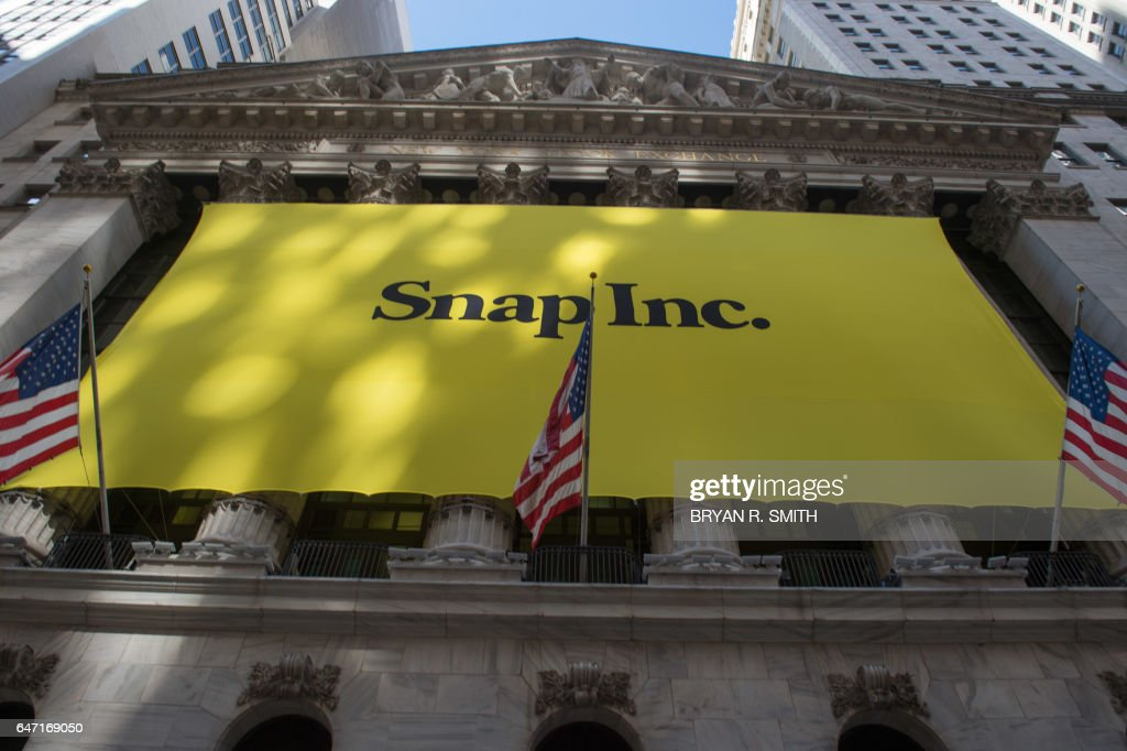 A Snap Inc. banner covers the facade of the New York Stock Exchange, March 2, 2017, in New York, as the Snapchat IPO debuts. Snapchat surged in its debut trade Thursday, jumping more than 40 percent from the level set in the initial public offering Wednesday night. / AFP PHOTO / Bryan R. Smith