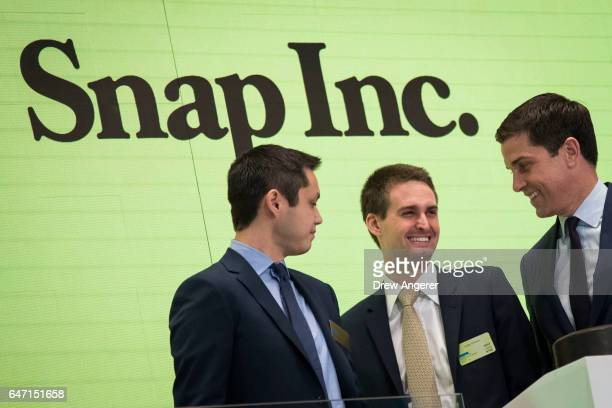 Snapchat cofounders Bobby Murphy chief technology officer of Snap Inc and Evan Spiegel chief executive officer of Snap Inc smile at each other after...