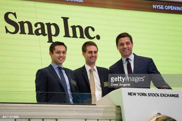 Snapchat cofounders Bobby Murphy chief technology officer of Snap Inc and Evan Spiegel chief executive officer of Snap Inc prepare to ring the...