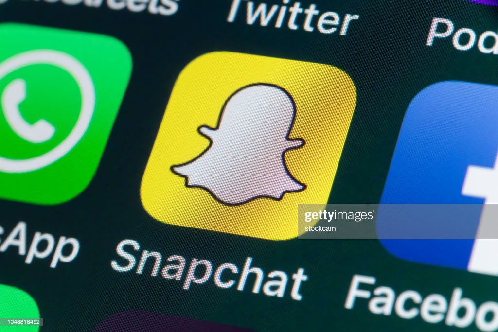 Snapchat, Facebook, Whatsapp and other phone Apps on iPhone screen : Stock Photo