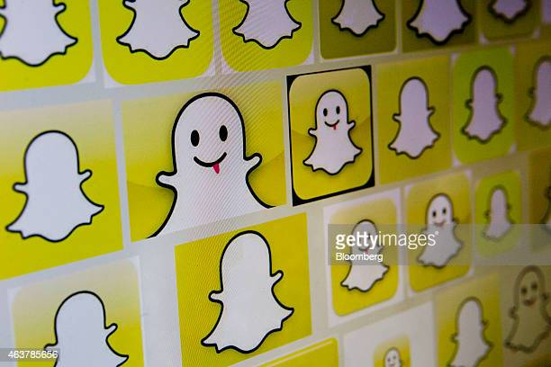 Snapchat Inc logos are displayed on a laptop computer in Washington DC US on Wednesday Feb 18 2015 Snapchat Inc is raising money that could value the...
