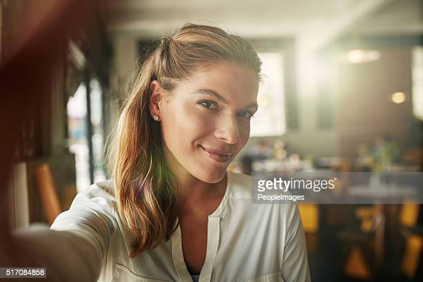 snapping selfies in the coffee shop - self portrait stock pictures, royalty-free photos & images