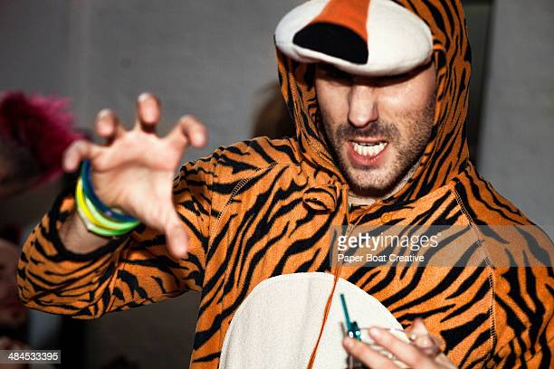 snapshot of student in a tiger onesie costume - animal costume stock pictures, royalty-free photos & images