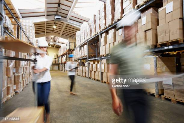 Snapshot of workers busy working at warehouse depot