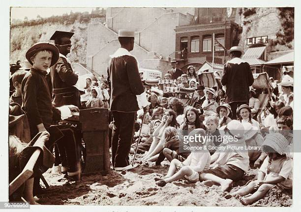 A snapshot photograph of a crowd on the beach in Broadstairs taken by an unknown photographer in about 1910 A large crowd of children and adults sit...