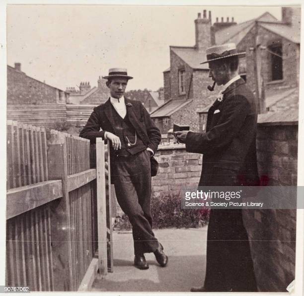 A snapshot photograph of a man using a Brownie camera taken by an unknown photographer in about 1900 Originally a shooting term the word 'snapshot'...