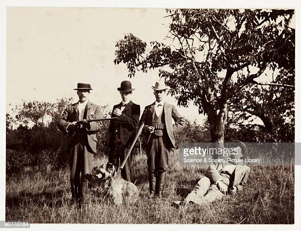 A snapshot photograph of four men members of a hunting party and their dog taken by an unknown photographer in 1902 using a No3 Folding Pocket Kodak...