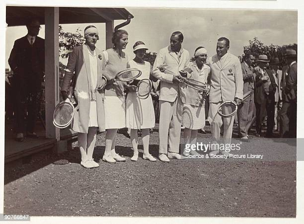 A snapshot photograph of group of tennis players taken by an unknown photographer Originally a shooting term the word 'snapshot' was first linked...